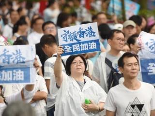 香港暴徒猖狂袭警并抢走女嫌犯,警察连开三枪